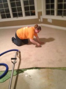 Sewage Backup Cleanup Technician completing job